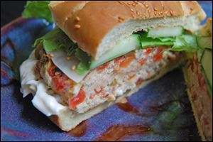 Quick-Ground Chicken Burgers can be dressed up with lettuce, tomato, or any of your favorite toppings.