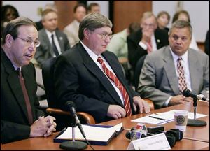 Former Ohio Gov. Bob Taft, left, appointed Rick Stansley, far right, to the University of Toledo Board of Trustees in 1999. When Mr. Stansley's term expired in June, 2009, UT President Lloyd Jacobs, center, named him University of Toledo Innovation Enterprises chairman and later hired him to run UTIE for $1,200 a day.
