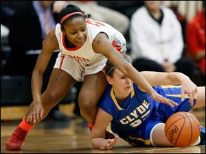 Clyde's Amanda Cahill (33) battles Central Catholic's Cierra Moran (24) for a loose ball.