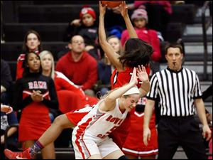 Rogers's Tori Easley (13) pulls in a rebound a against  Bowling Green's Hailey Maas (5).