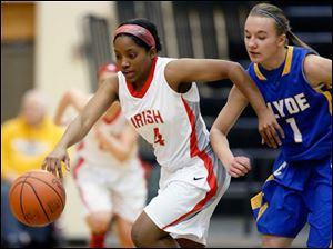 Central Catholic's Keytha Forman (4) steals the ball from Clyde's Melissa Laconis (1).