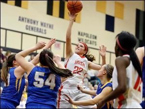 Central Catholic's Byrdy Galernik (22) shoots  against Clyde's Jill Miller (54).