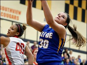 Clyde's Hannah Wadsworth (30) pulls in a rebound against Central Catholic's Demi Russell (40).