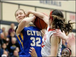 Clyde's Kelsy Michaels (32) shoots against  Central Catholic's Byrdy Galernik (22).
