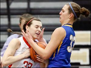 Clyde's Amanda Cahill (33) defends against Central Catholic's Michelle Murnen (33).