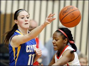 Clyde's Breanne Michael (11) passes the ball  against Central Catholic's Keytha Forman (4).