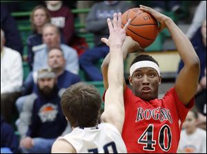 Rogers' Fadil Robinson (40) shoots against Lake's Todd Walters (10).