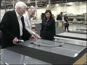 Michael Cicak, left, of Willard & Kelsey and manager Vince Poleo guide Labor Secretary Hilda Solis, one of several key Democrats to visit the firm, in 2011.