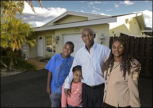 Ganel Appolon, with his family, from left, Stanley, Jessica, and his wife, Maude, lost his home three years ago in the economic downturn. They recently purchased this home in Fort Lauderdale, Fla. Housing experts say that  these so-called 'boomerang buyers' are key to sustaining the housing recovery.