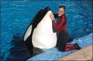 Dawn Brancheau, a whale trainer at SeaWorld Adventure Park, poses while performing in 2005. Brancheau was killed in an accident with a killer whale at the SeaWorld Shamu Stadium in February, 2010.