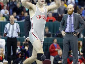 Central Catholic wrestler Alex Mossing celebrates his second state championship after defeating Mike Repko of Vermilion during their Division II 152-pound championship final match.
