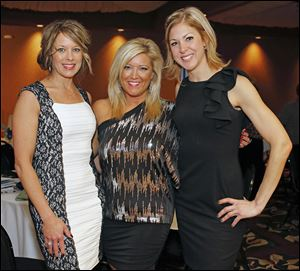 Left to right Sandra Robbins, Ann Marie Musto, and Jennifer Hildebrand during the Fur Ball to benefit the Toledo Humane Society Saturday, Feb. 8, 2014, at the Pinnacle in Maumee, Ohio.