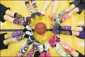 Colorful socks were a popular choice during the fifth grade Maumee Lady Panthers practice at the Maumee High School annex gym.