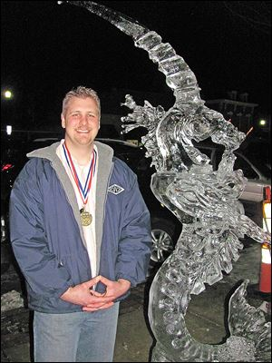 Gerald Ford stands with his ice sculpture 'Seahorse,' which won him the Professional National Ice Carving Championship award at Winterfest 2014 in Perrysburg.