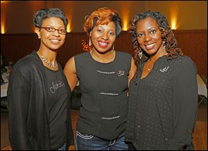 Members of the Toledo Chapter of Jack and Jill of America Inc. gather for a photo during the event, Kelli Winston, left, Patrice McClellan, center, and Arnyka Harris.