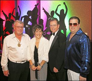 From left, Maumee Rotary President Greg Fish, with Michele Free, event chairman Tom Cox, and Jeff Keim at the Maumee Rotary's 'Rotary Night Fever' charity auction.