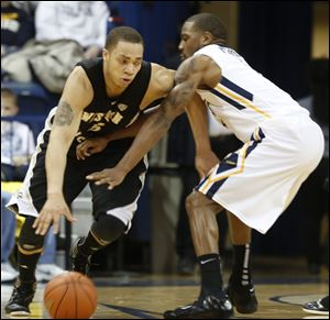 WMU's David Brown, 5, is defended by UT's Rian Pearson, 5.