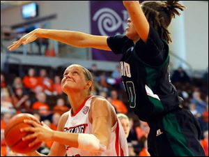 The Falcons' Jill Stein battles inside for a shot.