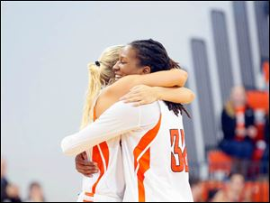 Bowling Green's Deborah Hoekstra gives senior Alexis Rogers a hug before Rogers exits the court during her last home game.