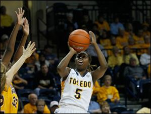 Toledo's Janelle Reed-Lewis shoots a 3 in the second half. Reed-Lewis was the game-high scorer with 24 points.
