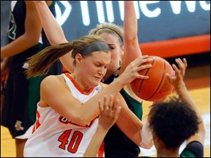 BG's Jill Stein battles to hold onto the ball away from Ohio University's Quiera Lampkins.
