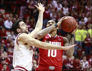 Indiana forward Will Sheehey, left, fouls Ohio State forward LaQuinton Ross on Sunday in Bloomington, Ind.