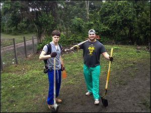 Noah Spielman, right, and a friend wielded pickaxes and shovels while on a mission trip to Honduras in January. The son of former OSU star Chris Spielman is expected to play nose tackle at Toledo.