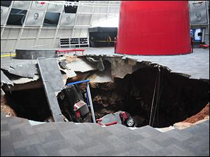 In this image provided by the National Corvette Museum shows several cars that collapsed into a sinkhole on Feb. 12 in Bowling Green, Ky.