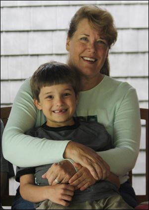 Raphael, with grandmother Janet Everhard, is holding his own.