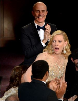 Cate Blanchett reacts after winning the award for best actress in a leading role for 'Blue Jasmine' during the Oscars.