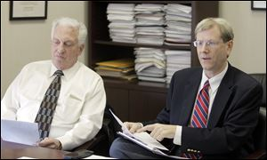 Ronald Rothenbuhler, Chairman of the Lucas County Board of Elections, left, and board member Jon Stainbrook visit offices of The Blade in 2013.