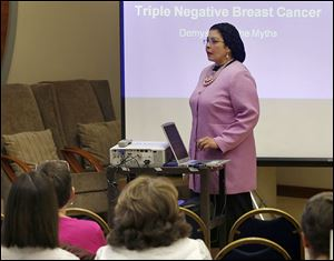 Dr. Iman Mohamed speaks at the Eleanor N. Dana Cancer Center in Toledo during the 'A Different Shade of Pink' program on Monday, which was Triple Negative Breast Cancer Day nationwide.