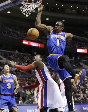 New York Knicks forward Amar'e Stoudemire (1) dunks on Detroit Pistons center Andre Drummond (0) during the first half.