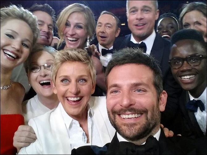APTOPIX 86th Academy Awards - Audience This image released by Ellen DeGeneres shows actors front row from left, Jennifer Lawrence, Meryl Streep, DeGeneres, Bradley Cooper, Peter Nyong'o, Jr., and, second row, from left, Channing Tatum, Julia Roberts, Kevin Spacey, Brad Pitt, Lupita Nyong'o and Angelina Jolie as they pose for a selfie during the Oscars. The popular posting crashed Twitter for a few minutes on Sunday.