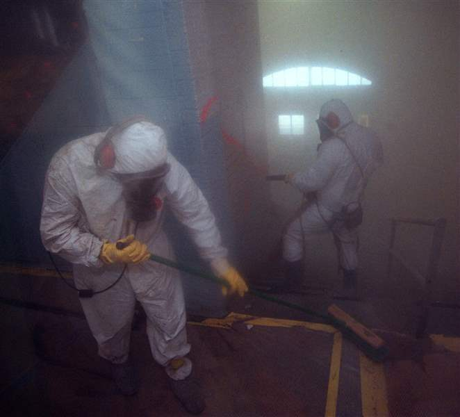 Workers-removing-lead-paint