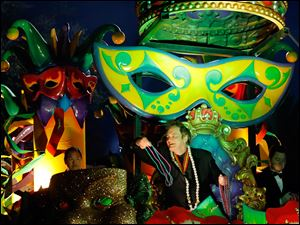 The Krewe of Orpheus rolls in uptown New Orleans, led by celebrity monarch Quentin Tarantino reigning over the superkrewe's 32-float parade on Lundi Gras, Monday.