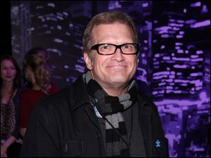 TV game show host Drew Carey has been paired with Cheryl Burke on 'Dancing With The Stars.'