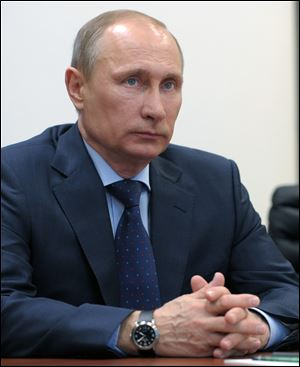 Vladimir Putin promises not to fight the Ukrainian people, easing tensions in the region next to Russia.