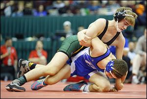 Richie Screptock, Clay's first state champ, battles Nick Kiussis of Brunswick in the Division I 132-pound final.