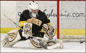 Northview goatender David Marsh blocks a shot against St. John's in the district final when he made 23 saves.