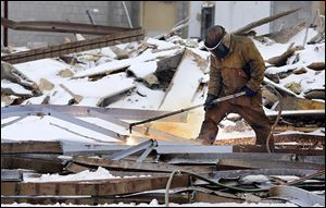 Demolition crews tear down the Woodville Mall  in Northwood.