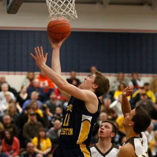 Toledo-Christian-s-Kyle-Kempton-drives-to-the-basket