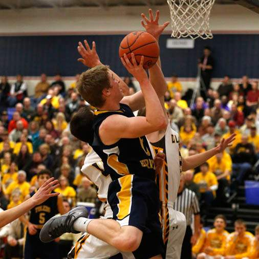 Toledo-Christian-s-Kyle-Kempton-is-fouled-by-Old-Fort-s