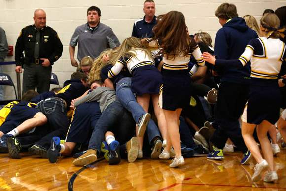 Toledo-Christian-fans-and-cheerleaders-pile-on-top-of-the-team