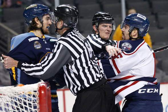 Toledo-s-Tyler-Elbrecht-and-South-Carolina-s-Dale-Mitchell-are-separated-by-referees-1