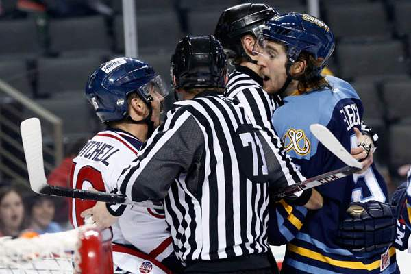 Toledo-s-Tyler-Elbrecht-and-South-Carolina-s-Dale-Mitchell-are-separated-by-referees