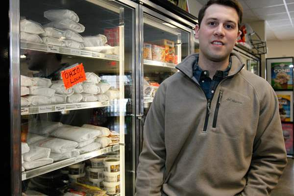 Zac-Oswald-of-Berkey-next-to-freezer-with-locally-pr