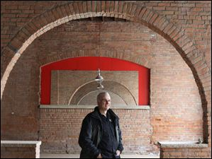 Tom Schaeffer, the CEO and owner of the soon to open Black Cloister Brewery, stands in the pub's future location in downtown Toledo.
