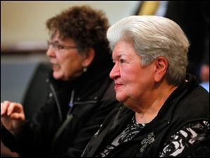 Suzanne Smith, left, and Loretta Miller, right, who supported preserving the Seneca County Courthouse before it was destroyed.