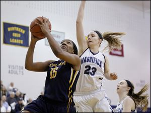Notre Dame's Kaayla McIntyre shoots against Rocky River Magnificat's Bridget Pryatel, right.